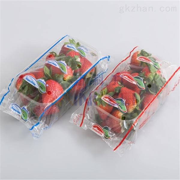 新科力托盘装番茄-果蔬带托盘包装机